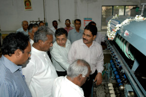 Hon'ble Union Minister of Textiles Dr. K. Sambasiva Rao keenly observing the 10-end concept model of automatic reeling machine
